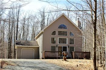 This nearly new custom built home features cathedral ceiling wi...