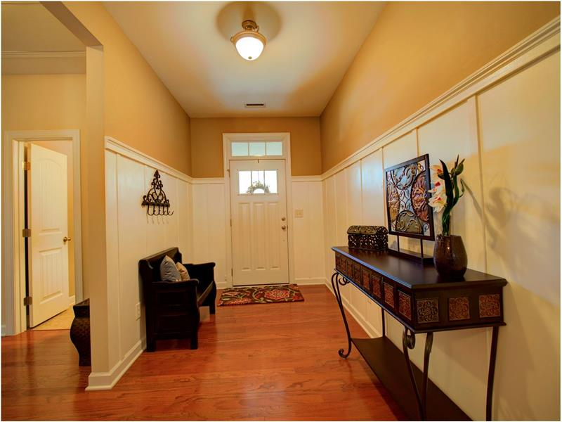 Spacious Foyer with Wood Trim