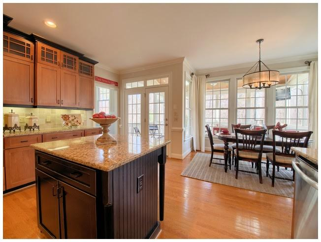 Large Island and additional cabinets and lighting at top