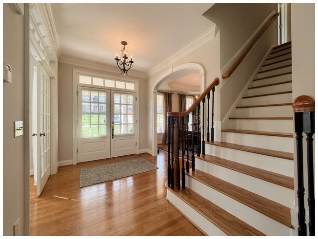 Stunning Foyer with wood floors and wood treads on stairs