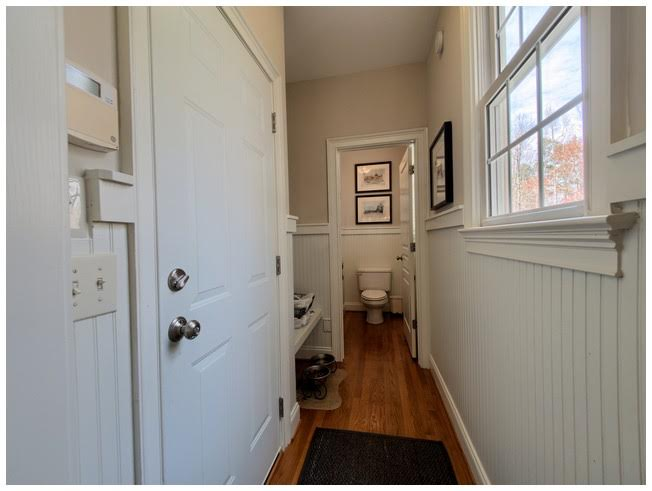 Mudroom and 1/2 Bath tucked away from main traffic areas