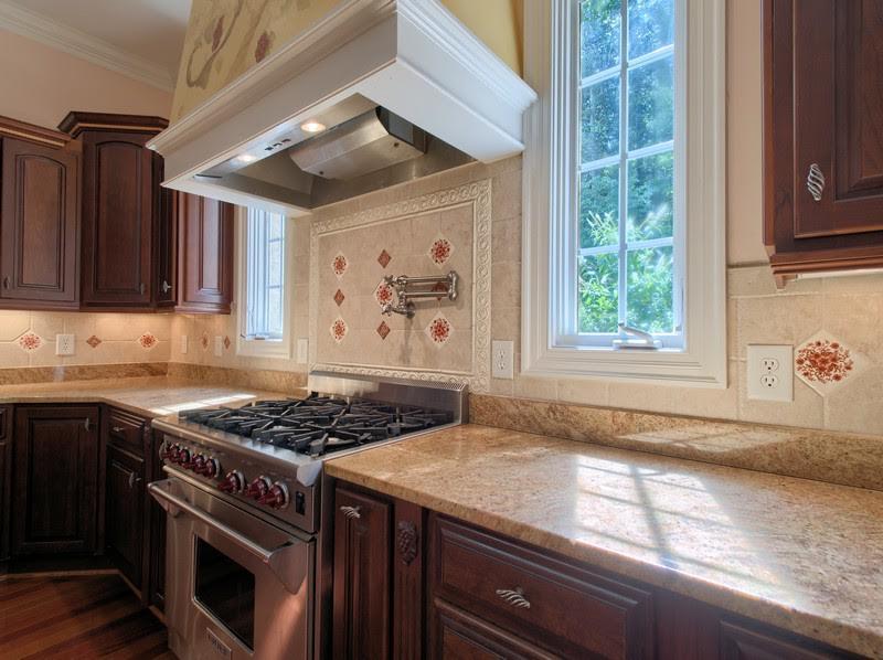 Kitchen - gas stove, pot filler, tile backsplash