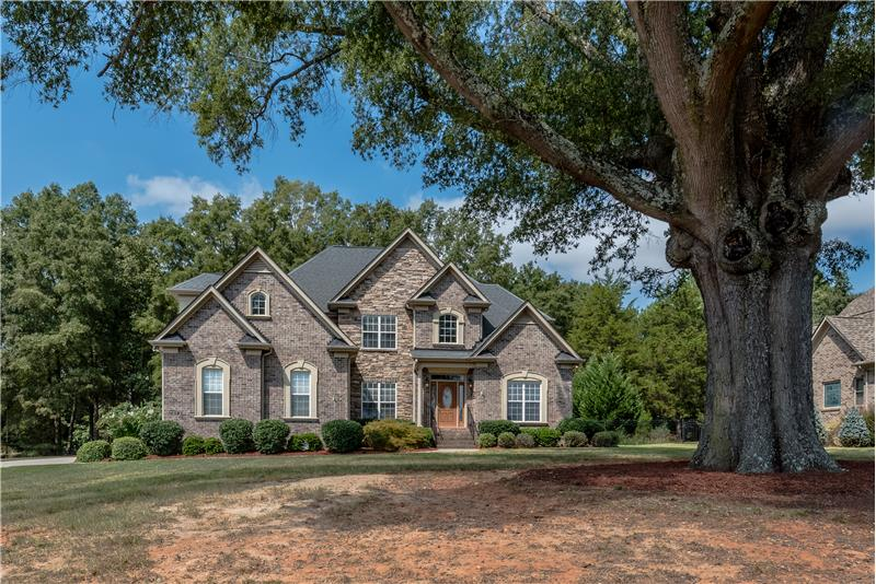 Custom built home on .93 acres set against a backdrop of mature trees.