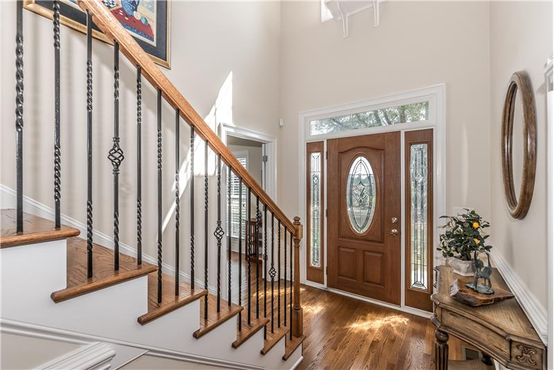 Dramatic, 2-story center hall foyer; front door with leaded glass insert and side lights.