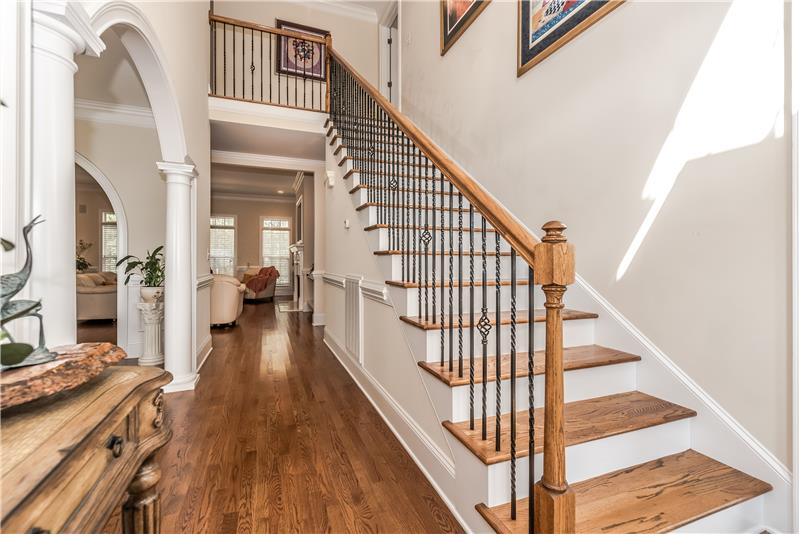 Gracious and inviting foyer welcomes you with flowing hardwoods, millwork.