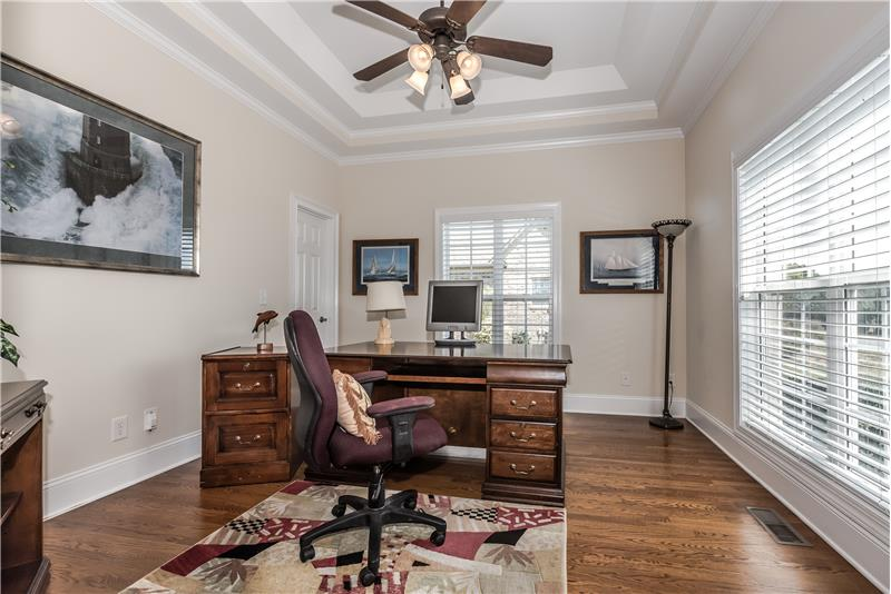 Home office/study features double trey ceiling, hardwoods, great natural light.