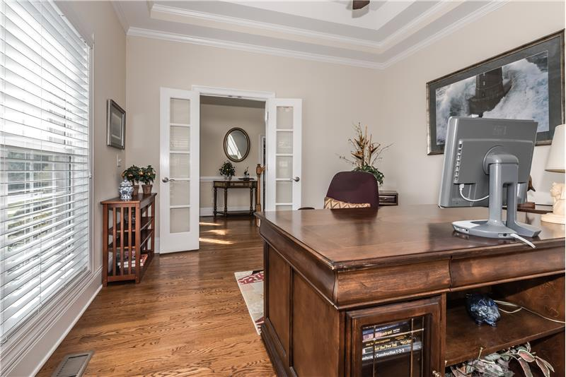 Privacy in the home office is enhanced by double, French-style doors.