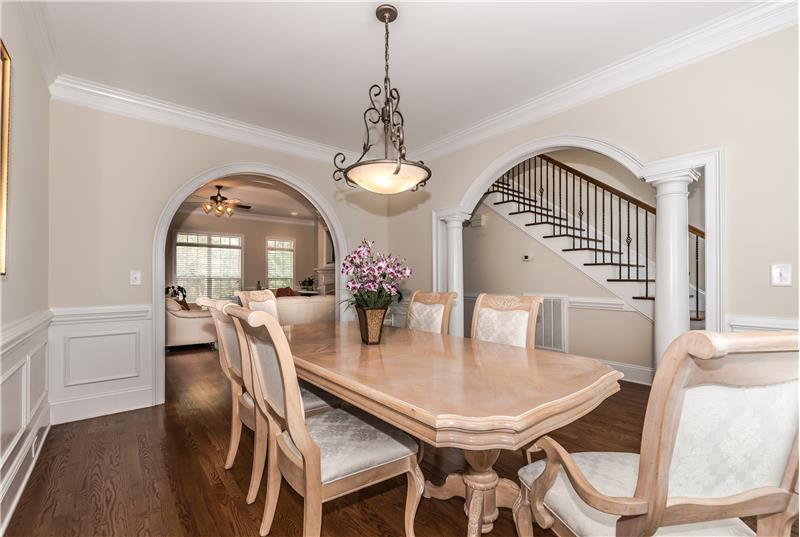 Step through dramatic arched entries into the dining room enhanced by gleaming hardwood floors and generous millwork.