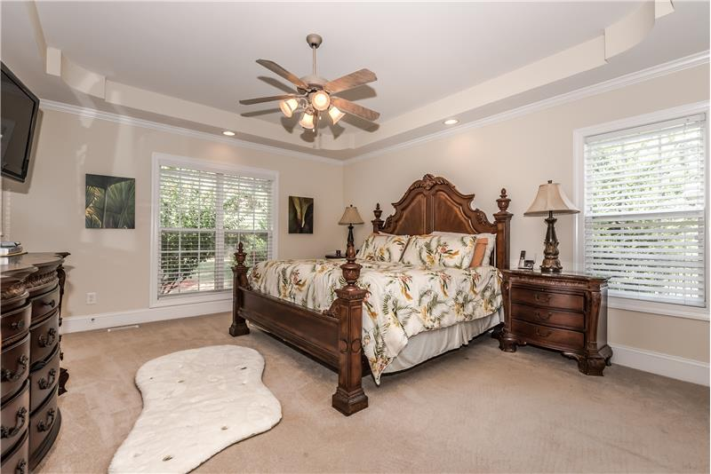 Serene and spacious master suite on first floor of home.