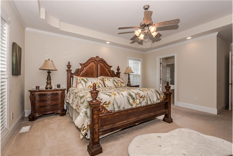 Plenty of room for king size bed and larger dressers in master bedroom.