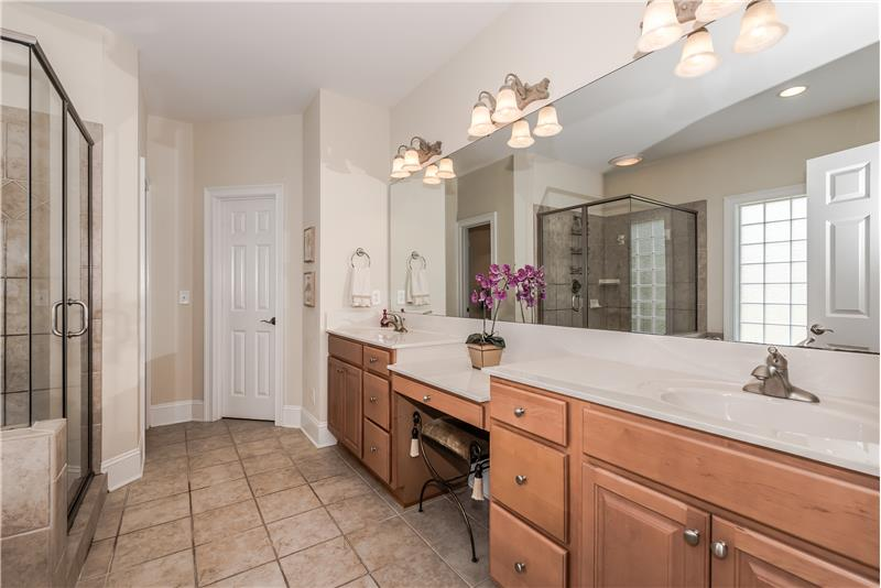 Expansive double sink vanity in master bathroom + private WC with sink; large walk-in closet.