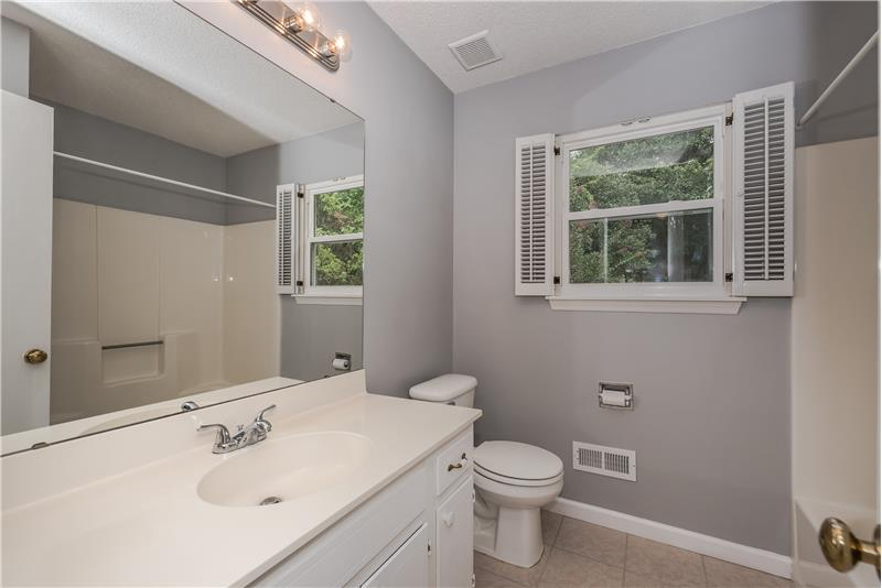 Updated hall bathroom shared by secondary bedrooms