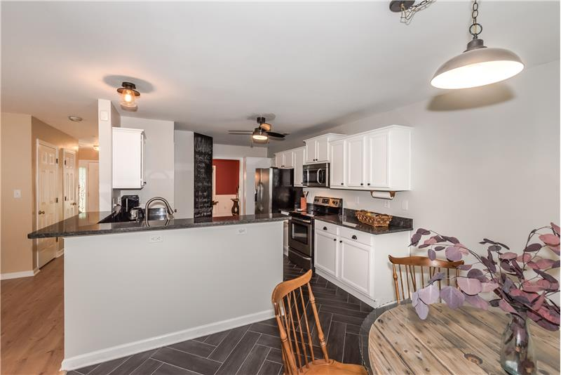 Recently remodeled kitchen with new granite counters and stainless steel appliances.
