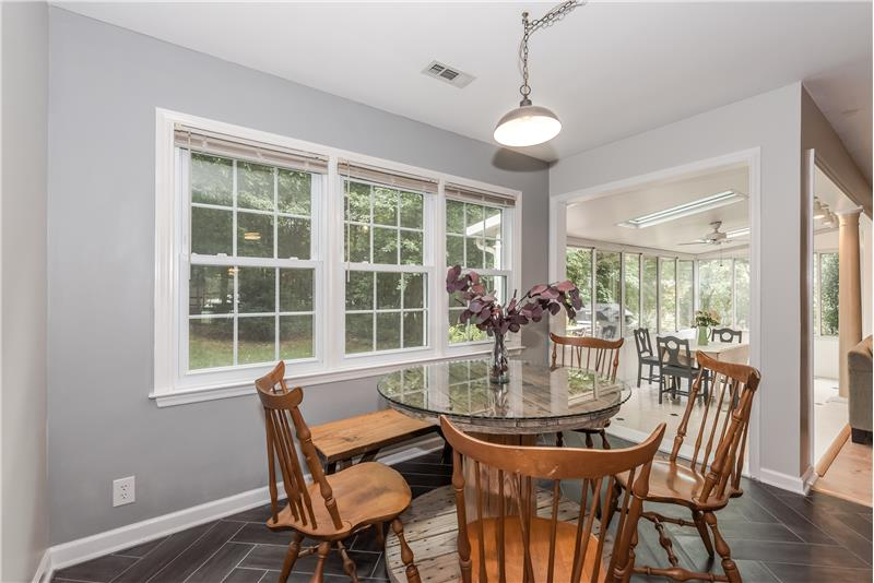Breakfast area overlooks great room and sunroom. Ideal for daily meals and casual entertaining.