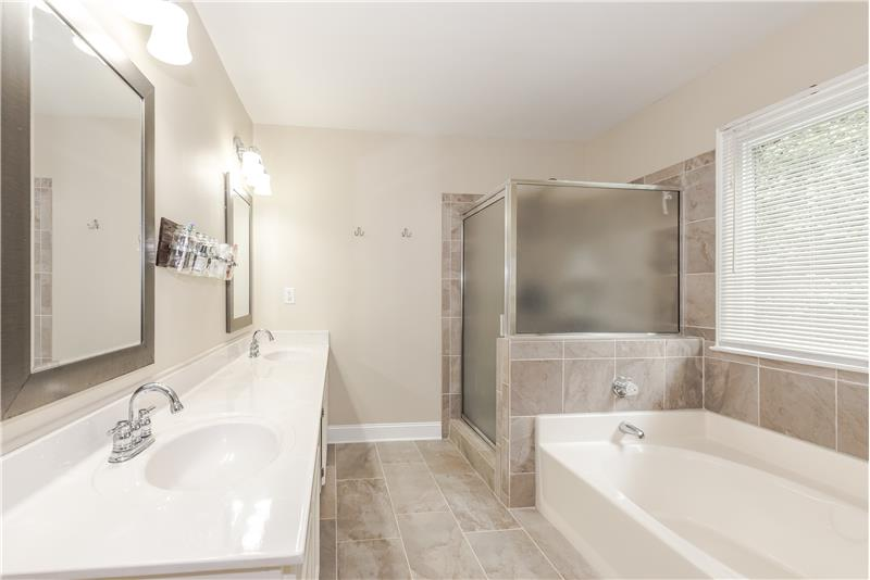 Spa-inspired, updated master bath with separate shower and tub.