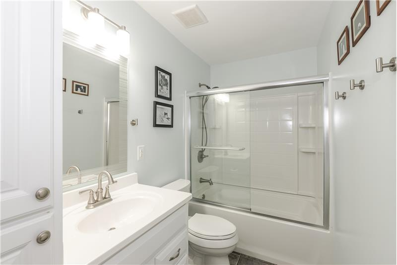 Updated bathroom shared by the secondary bedrooms on upper floor.