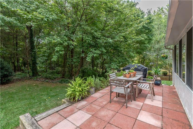 Beautiful paver patio further extends the home's living and entertaining areas.