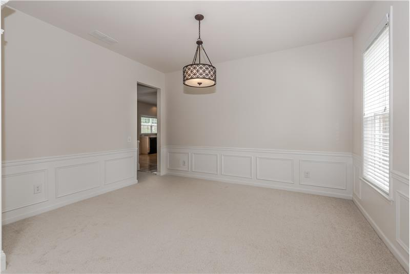 Formal dining room ideal for holiday gatherings and more formal entertaining