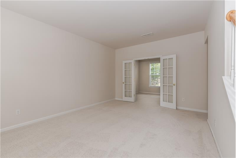 Formal living room with study/home office behind