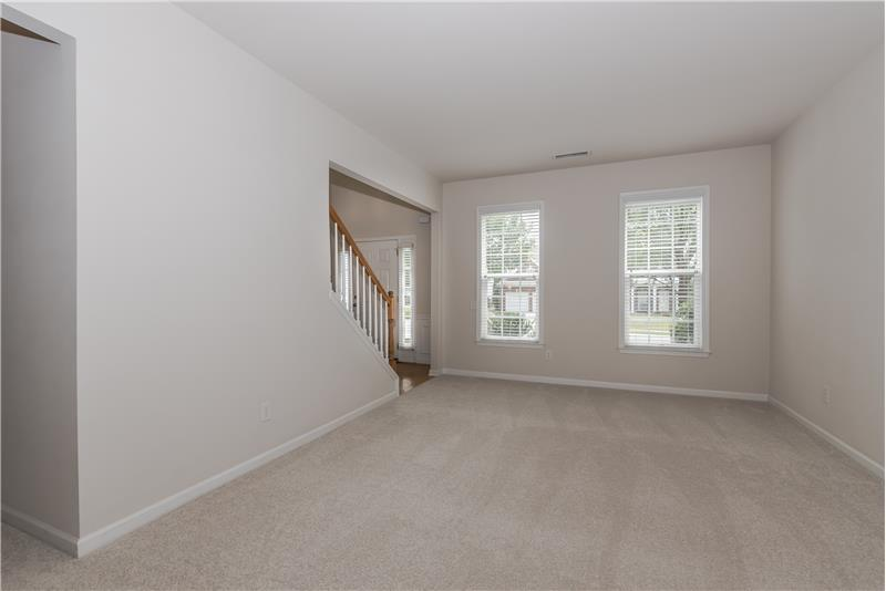 Formal living room features new carpet and fresh paint