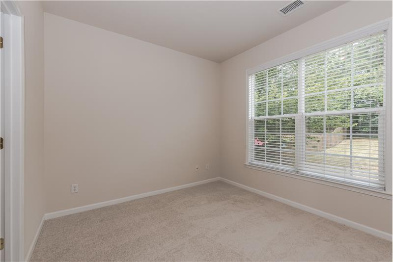 Home office/study with French doors for privacy behind formal living room