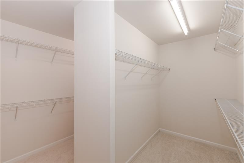Huge walk-in closet in master suite with room for