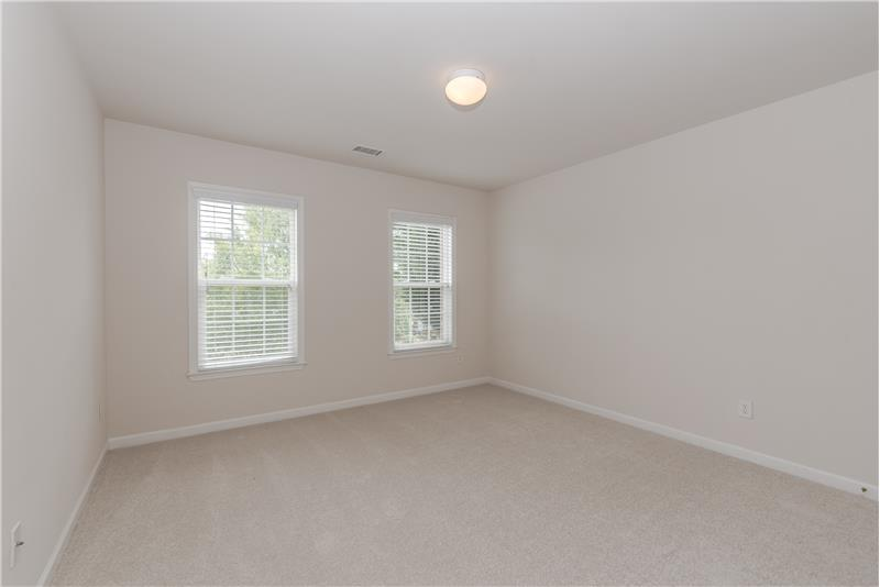One of three additional bedrooms on second floor, all with new carpet and fresh paint