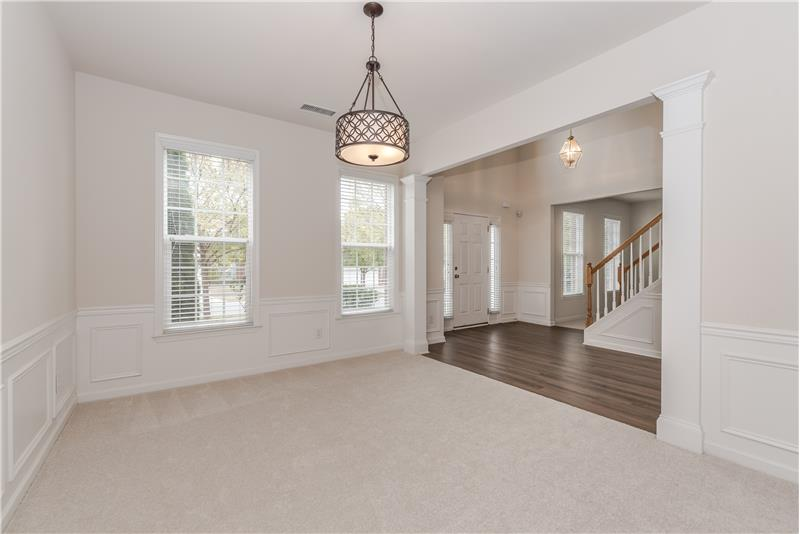 Formal dining room opens to foyer and has open sight lines to the formal living room