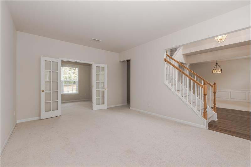 Formal living room opens to foyer and dining room