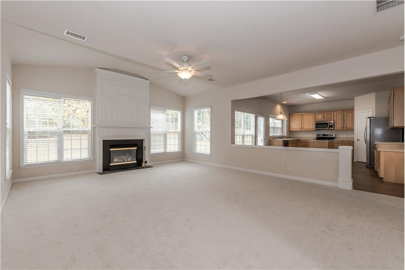 Large great room with gas fireplace and decorative mantel