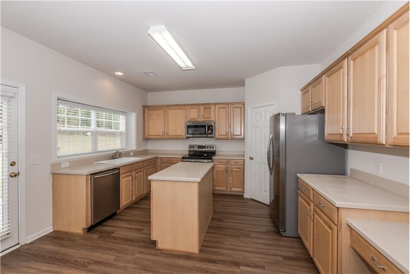 Brand new flooring and brand new complement of stainless steel appliances