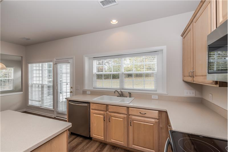 Kitchen overlooks the backyard and is very bright and sunny