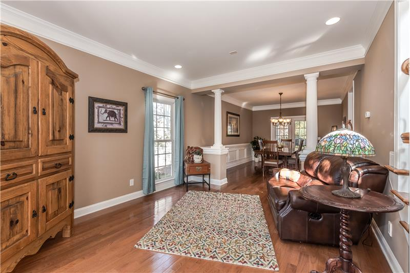 Living room features hardwood floors, crown molding, recessed lighting.
