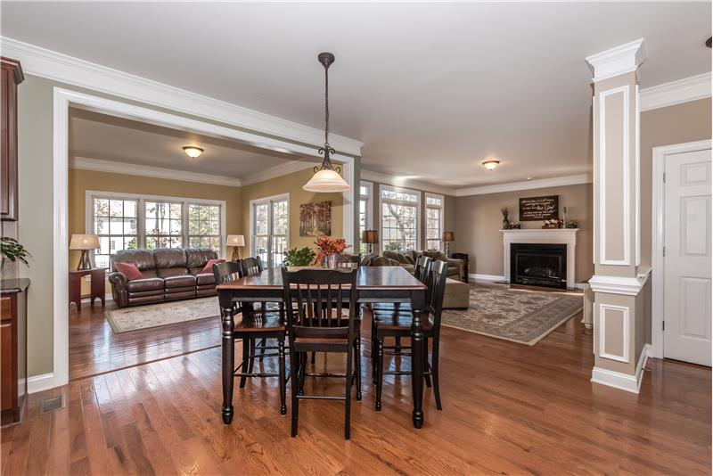 Breakfast area with open sight lines to both sun room and family room.