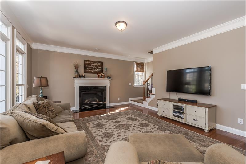 Family room provides wall space for large screen TV.