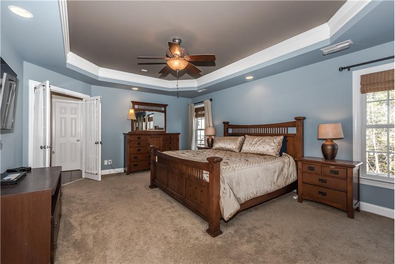 Serene and spacious master bedroom with space for king-size bed, larger dressers. Situated totally separate from other bedrooms.