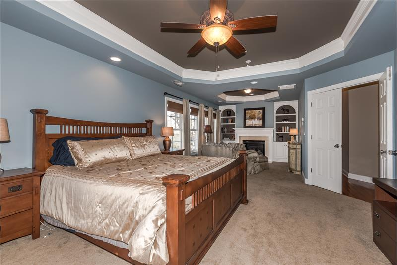 Master suite is a true private oasis with its own sitting area with fireplace, two trey ceilings, recessed lighting.