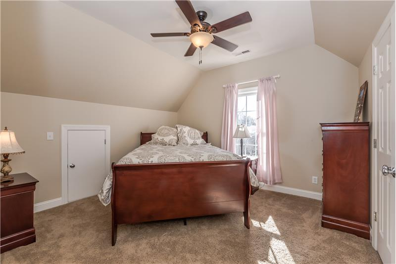 One of three additional bedrooms on second floor of home.