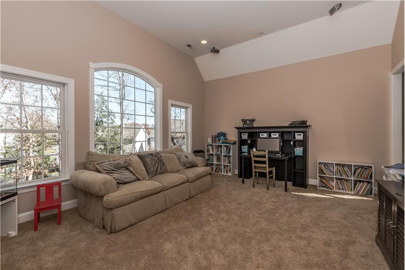 Large second floor bonus room with raised ceiling, large picture windows.