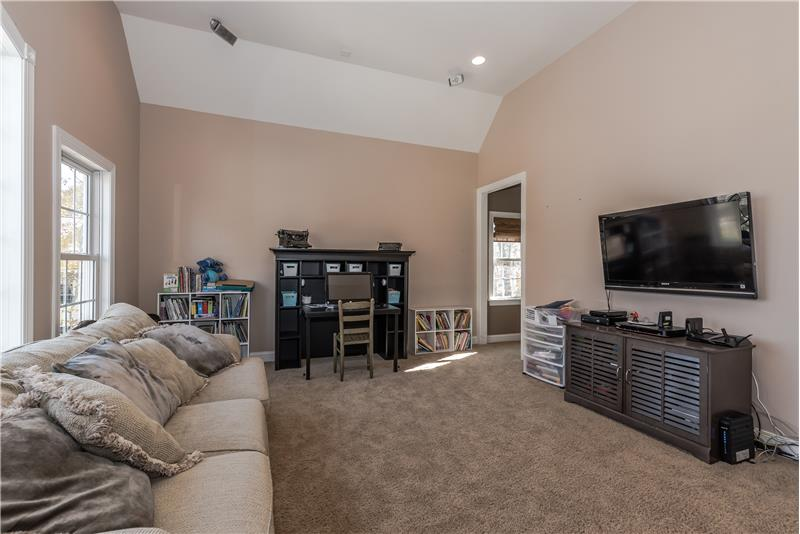 Bonus room perfect for use as a playroom, TV room. Plenty of wall space for large screen TV.