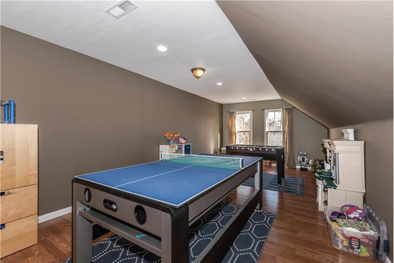 Third floor recreation room ideal for those game tables. Recessed lights, wood laminate floors.