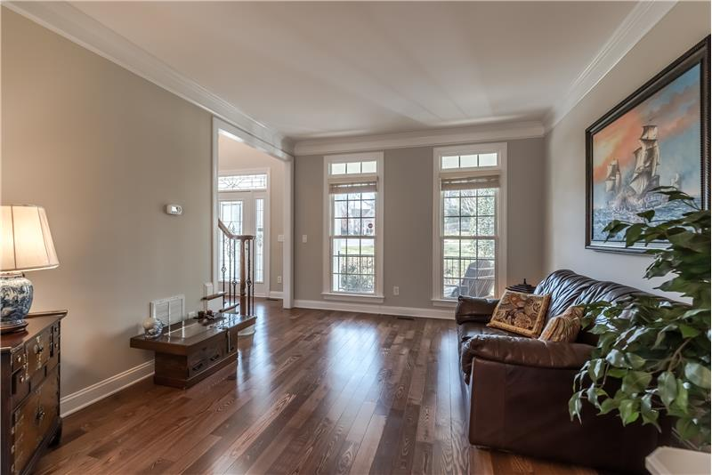 French-style windows with transoms provide wonderful natural light. Open sight lines to foyer.