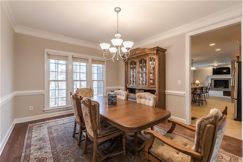 Dining room features gleaming hardwood floors, generous mill-work, French-style windows.