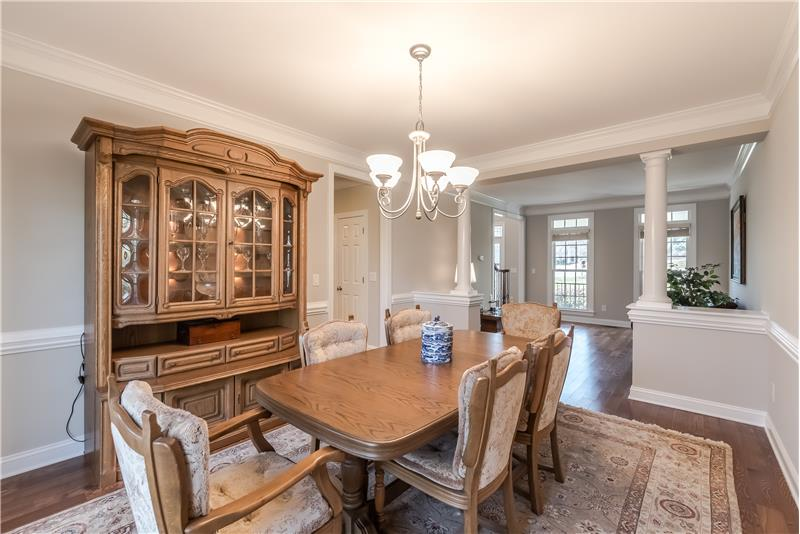Elegant dining room with generous millwork ideal for holiday meals and more formal entertaining.