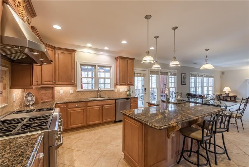 Features tile floors, tile back-splash, recessed lights, pendant lights, under-cabinet lights.