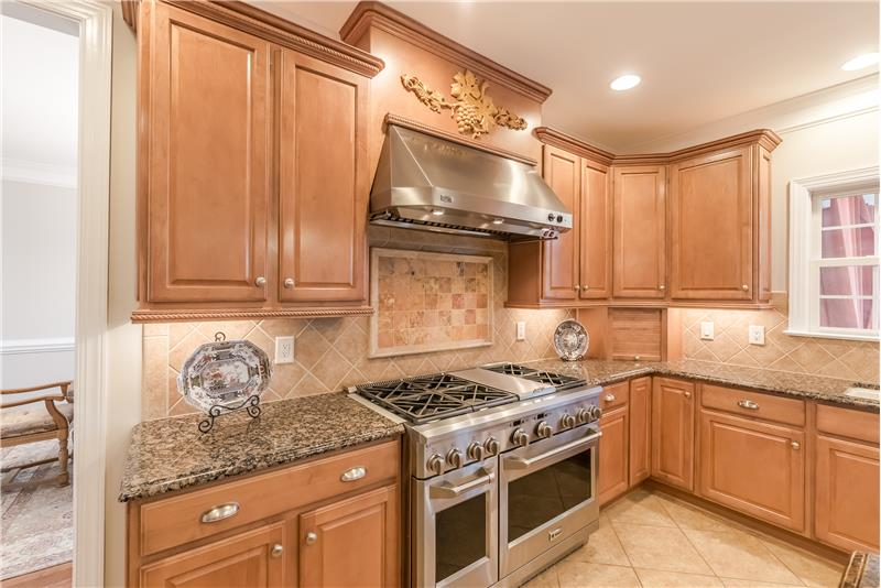 Upgraded stainless steel appliances include a GE Monogram, dual fuel, professional style convection range with 6 burners, grill.