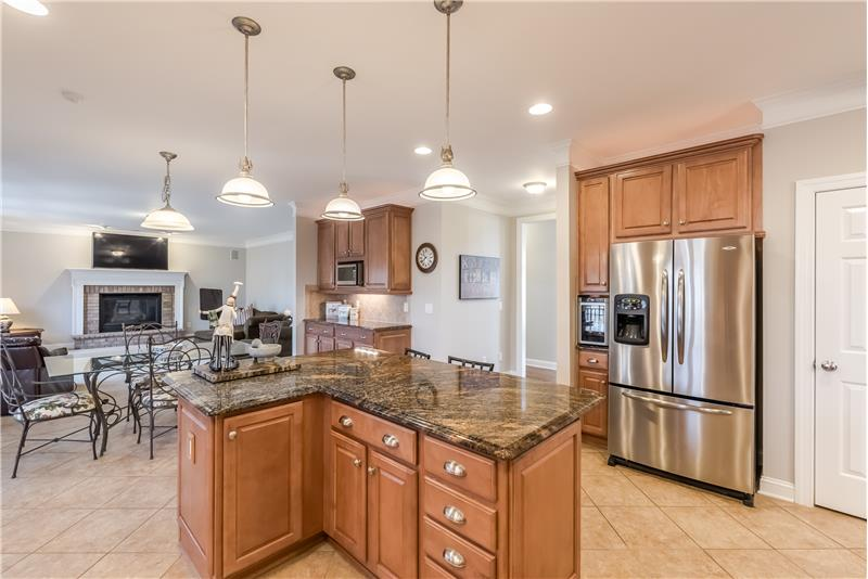 Kitchen island provides both additional storage and seating. Open sight lines to the breakfast area and great room.