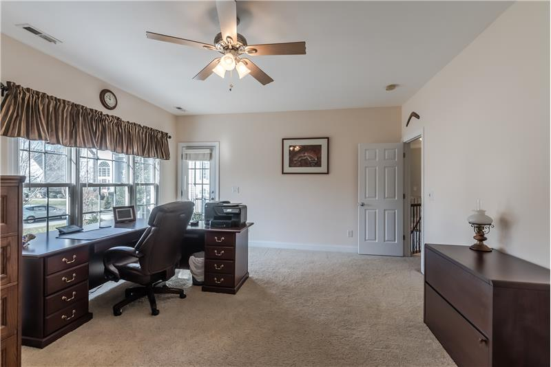 Second floor recreation/bonus room, currently used as an office. Spacious enough for a pool table. Access covered porch.