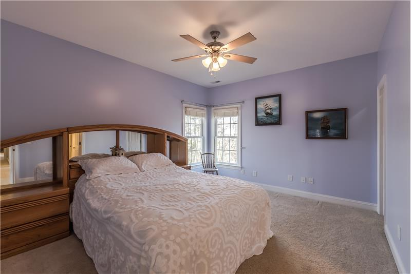 One of three additional bedrooms on second floor of home; features a