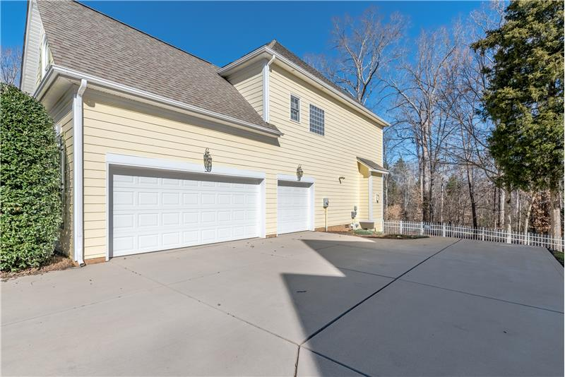 3-car side-load garage provides plenty of room for parking and storage. Large driveway offers additional parking space.